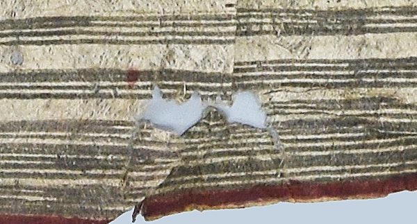 Colour photograph of a damaged area at the edge of a striped Hawaiian cloth, GLAHM E.601, before humidification and realignment (copyright University of Glasgow)