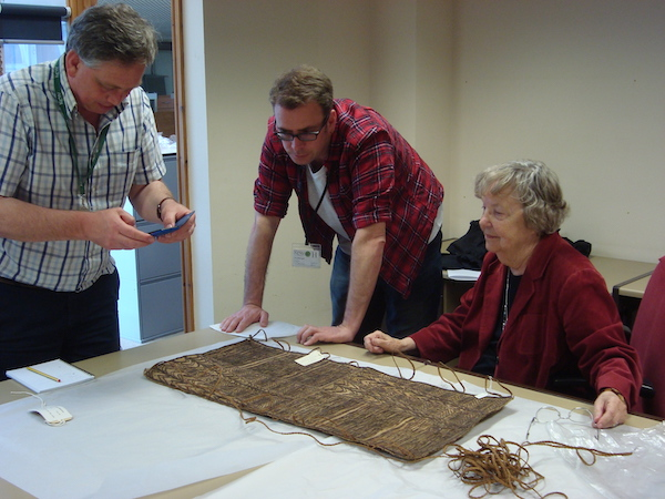 Colour photograph showing Andy Mills (centre) with Mark Nesbitt and Adrienne Kaeppler, at the Economic Botany Collection, Kew (copyright University of Glasgow)