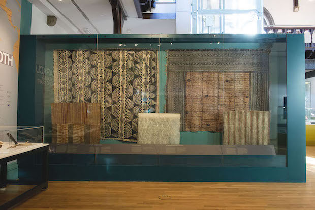 Colour photograph of the final case of the exhibition Barkcloth: Revealing Pacific Craft, displaying large cloths from The Hunterian collection, demonstrating the variety in the quality of the cloth and the range of decorative techniques used (copyright The Photographic Unit, The University of Glasgow)