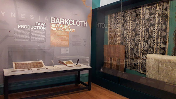 Colour photograph showing tapa cloths and tools on display at The Hunterian in the Barkcloth: Revealing Pacific Craft exhibition, 2019 (© copyright University of Glasgow)