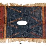 Kew EBC 42861. Colour photograph of a Samoan tiputa or poncho, hand-painted in the tradition of siapo mamanu cloths. The brownish-red panels are over-painted with a top layer of varnish-like Parinari insularum fruit juice. The tiputa was donated to Kew in 1866. (copyright Economic Botany Collection, Royal Botanic Gardens, Kew)