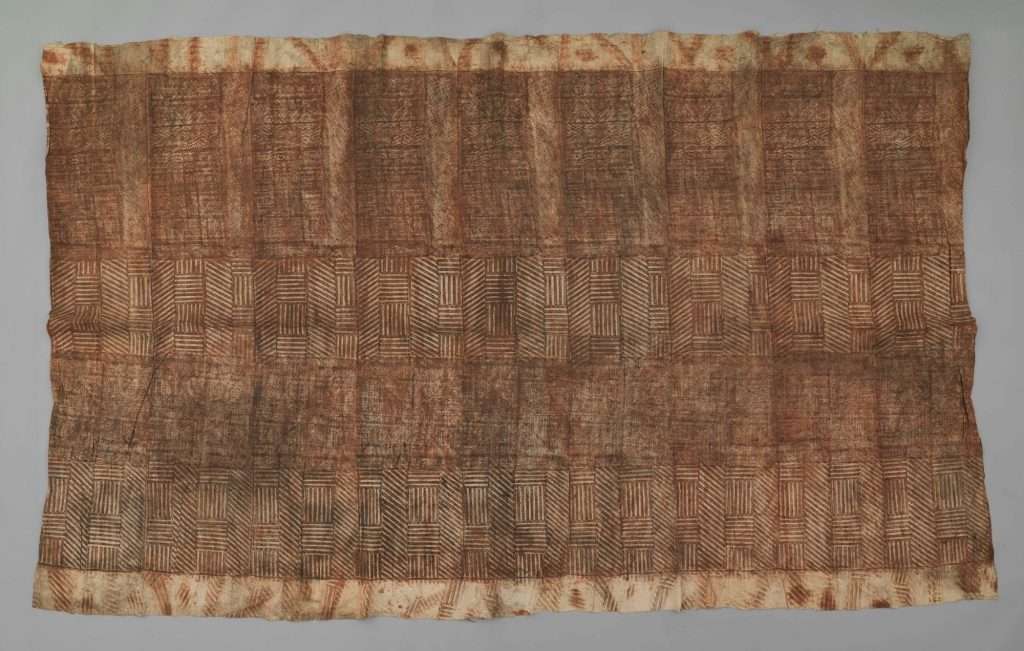 The Hunterian GLAHM E.417/8. Colour photograph of a fine sample of Tongan ngatu tahina is one of a small number of Hunterian objects which can be matched with a sample in the University of Göttingen's collection (Oz.599). Stylistically, it was produced with the typical Tongan composition method: sheets of bast are pasted together at their edges into a double-layered cloth, and rubbed over a set of intricately patterned kupesi rubbing tablets with koka juice. (copyright The Hunterian, University of Glasgow; photograph supplied by The Photographic Unit, The University of Glasgow)