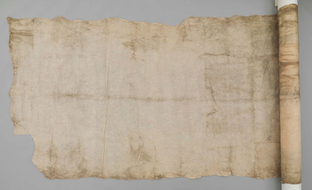The Hunterian GLAHM E.457/6. Colour photo of a thin, papery-textured Tahitian hopū fabric with a fine linear beater mark of ten grooves per centimetre. This sample was formerly part of a larger fabric sample (sixteen feet six inches by ten feet six inches, along with its sibling-samples GLAHM E.594/4 and E.594/10). (Copyright The Hunterian, University of Glasgow. Photograph supplied by The Photographic Unit, The University of Glasgow)