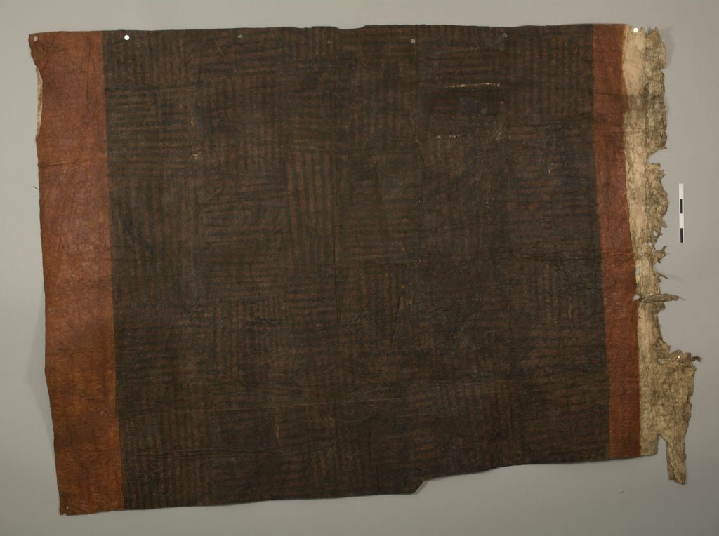 The Hunterian GLAHM E.458/5. Colour photograph of a sample of Tongan ngatu 'uli ('black barkcloth'), one of the oldest known pieces of Tongan tapa in the world. Another piece of the cloth, with the same distinctive rubbed decorative pattern (an early form of 'efu), is in the Forster Collection at the University of Göttingen's museum (object Oz.631), ostensibly collected on Cook's second-voyage visits to Tonga (1773 and 1774). (Copyright The Hunterian, University of Glasgow. Photograph supplied by The Photographic Unit, The University of Glasgow)