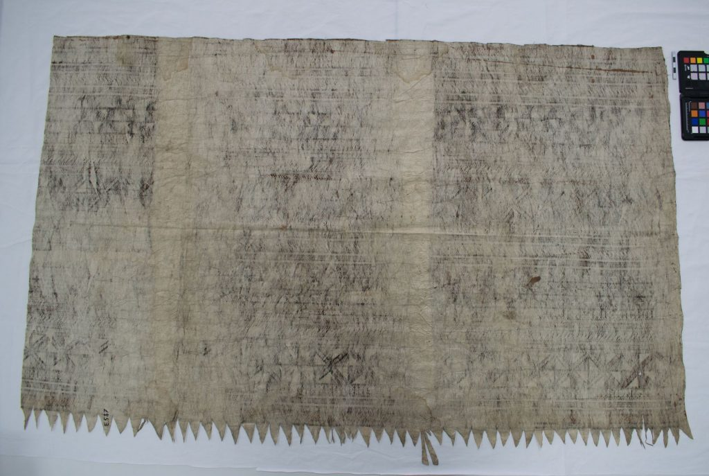 The Hunterian GLAHM E.537. Colour photograph of the reverse side of a sample of a late 19th century Fijian masi kesa fabric. This sample is a small section of the outer border of a much larger fabric (copyright The Hunterian, University of Glasgow)