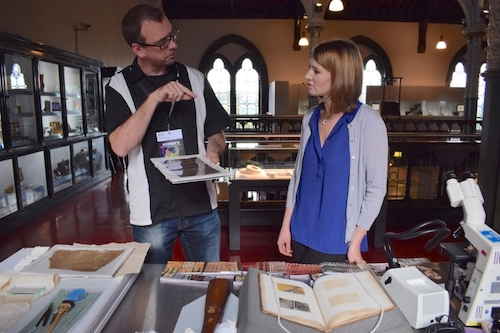 Colour photograph of Dr Andy Mills, Historical Research Associate, explaining the provenance of Pacific barkcloth samples to a visitor to the Hunterian Museum, University of Glasgow, during European Researchers' Night, 2016 (copyright University of Glasgow)