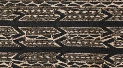 Colour photograph of a detail from a tikoru fabric showing non-figurative decorative features typical of Rarotongan tapa; object reference RBGK 42953 from The Economic Botany Collection, Kew (copyright The Trustees of the Royal Botanic Gardens, Kew)