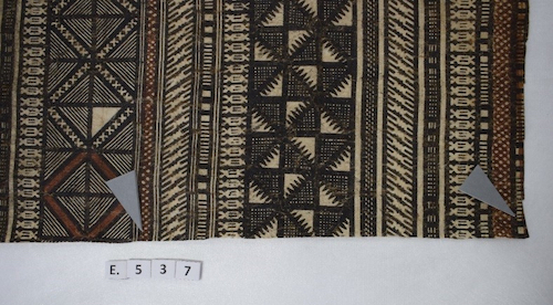 Colour photograph showing the lower right corner of cloth GLAHM E.537 from the Hunterian collection. Markers indicate where samples were taken for analysis (copyright University of Glasgow)