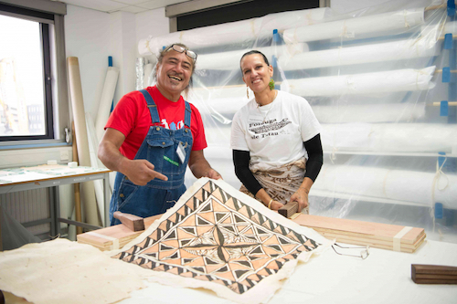 Colour photograph of Uilisone Fitiao and Reggie Meredith Fitiao displaying a Samoan barkcloth completed during the course of the workshop. (copyright University of Glasgow)