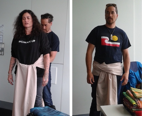 Colour photograph of Pacific artists, Rosanna Raymond and Numangatini MacKenzie, demonstrating ways of tying the maro or loincloth. This took place at an event organised by the University of Auckland Business school where Andy Mills presented his research on the malo or maro (copyright University of Glasgow)